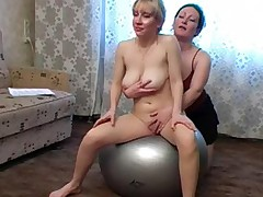 Big boobed nude chick satisfied by a lesbian instructor