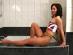 Gymnast in pantyhose does the bath exercises