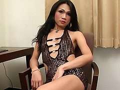 Mean slutty Thai tranny strips and wanks