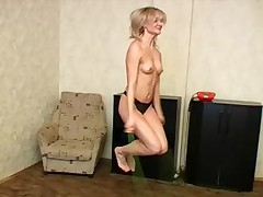 Nude blondie jumps and does the hamstring stretches