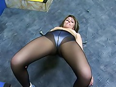 Girl in black pantyhose squats and does yoga