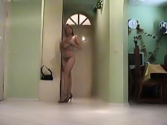 Sexy chick undressing under spy cam control
