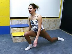 Sporty miss stretches her pantyhosed legs