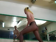 Blonde gymnast in black pantyhose has gym time