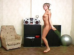 Nude sports girl exercises with a fitness ball
