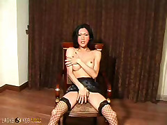 Hung ladyboy with fishnets gets off in a chair