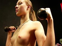 Dumbbell and gymnastic exercises by a bare gal