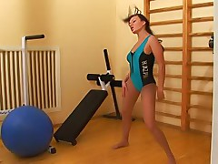 Sexy pantyhose gym training of a sports girl
