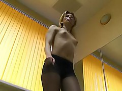 Topless blondie in black pantyhose exercises at the gym