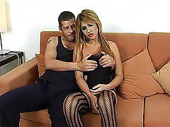 Blonde shemale dazzler Dee Dee in stripy stockings