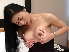 Super smooth ladyboy plays with her hole