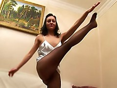 Brunette in black pantyhose doing the morning workouts