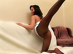 Home gymnastics in black fishnet pantyhose