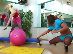 Two gym gymnasts in pantyhose having fun