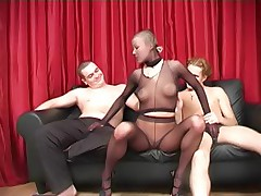 Two pantyhosed guys stuffing a juicy chick