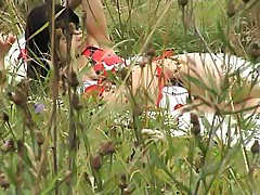 Topless sunbathing brunette filmed on voyeur cam