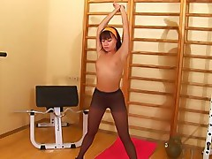Gym exercises of a sporty girl in black pantyhose