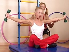 Sporty blondie lured by a lesbian trainer