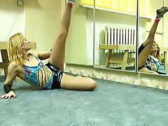 Blonde pantyhosed girl doing the gym drills