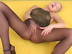 Lascivious girl jilling off in black pantyhose