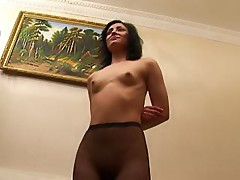 Brunette in black pantyhose does the home workouts