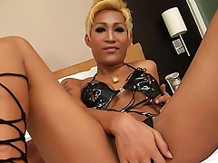 Blonde ladyboy Patty shows up in her latex bikini