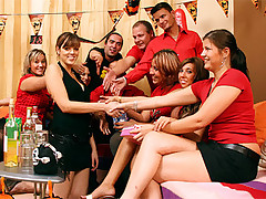 Hot teens fucking and sucking at a naughty groupsex party