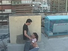 Latina couple watched by security cam