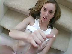 Slim blonde teen nymphet Kelly Wells gives handjob on the stairs