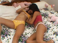 Slender lesbians Taylor and Brit licking and fingering their skinny bald pussies