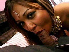 Over sexed Indian slut sucking a huge black prick in a threesome