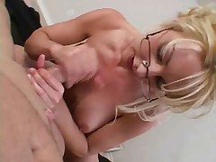 Blonde seductress in glasses Sinfy Lange gives handjob for fresh sperm