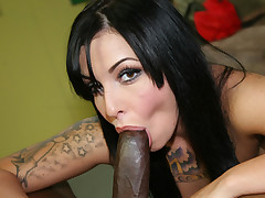 Tattooed slut does all she can to milk big, black cock