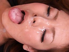 Hitomi Tanaka sticks out her tongue to receive his warm sperm