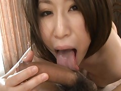 Yuuka Tsubasa uses her tongue on her boyfriends huge cock