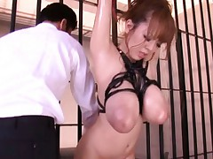 Hitomi Tanaka Asian doll tied up in jail gets loose showing tits