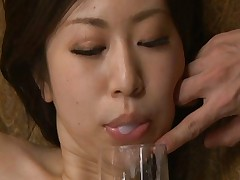 Yuuka Tsubasa spits sperm into her mouth as he ass is fucked