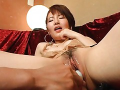 Miku Tanaka has pussy spread and dildo inserted in her wet cunt