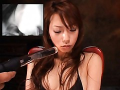 Riri Asian with handcuffs gets vagina screwed with weird sex toy