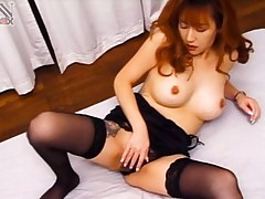 Fujiko Komine Asian with big cans rubs her vagina over thong