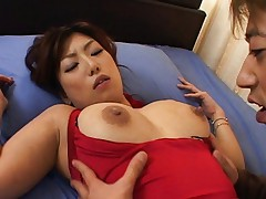 Naho Hazuki pulls down her dress to show her large tits