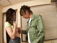 Nanako Yoshioka shows her tits to a younger lover in this video