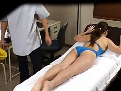 Japanese AV Model gets lotion on big jugs on and under bath suit