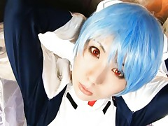 Mirina Izumi in her cosplay costume with a blue wig