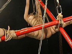 Nei is a horny Asian milf who gets tied up and she gets an enema
