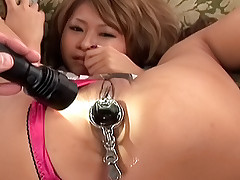 Hitomi Mano Japanese babe has her holes spread for some big double headed toys