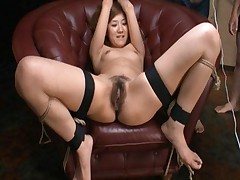 Karin Tsubaki on her knees sucking hard cocks