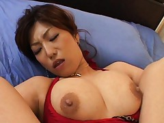 Naho Hazuki shows her boobs while her wet pussy is touched