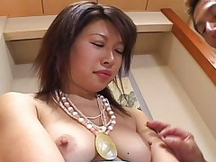 Miki Uehara removes her shirt to show off her nice tits