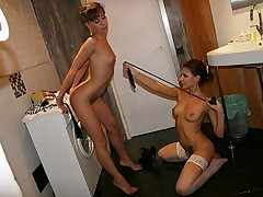 Naked lesbians fuck in the bathroom